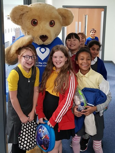 Christie Bear with Y4 and Y5 pupils from Beaver Rd Primary School