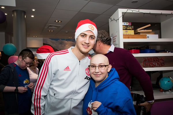 Caitlin meets Diogo Dalot at The Christie Hospital 2.jpg