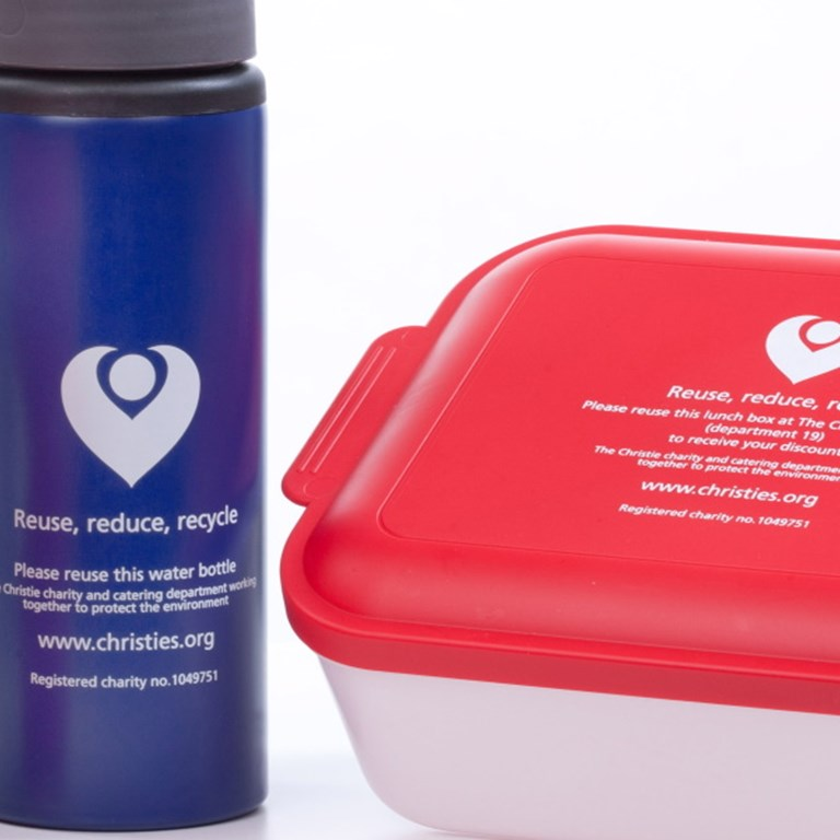 A photo of The Christie reusable containers, including the travel mug, water bottle and lunchbox.