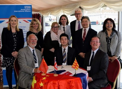 The Christie International team members signing a deal with a Chinese hospital.